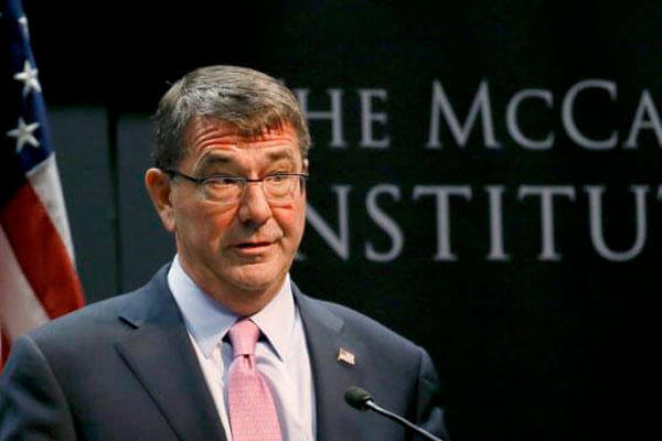 U.S. Secretary of Defense Ash Carter waits to speak, Monday, April 6, 2015, at the McCain Institute at Arizona State University in Tempe, Ariz. (AP Photo/Matt York)