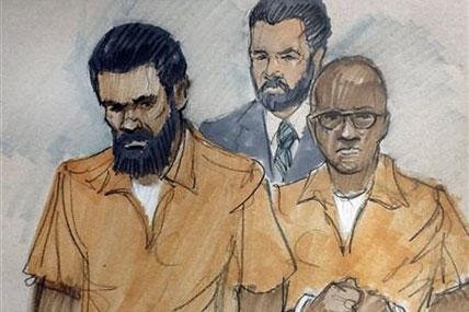 In this courtroom sketch, Jonas M. Edmonds, left, and Hasan R. Edmonds, right, stand in front of an FBI agent as they appear at a hearing at federal court in Chicago, Thursday, March 26, 2015 (AP Photo/Tom Gianni)