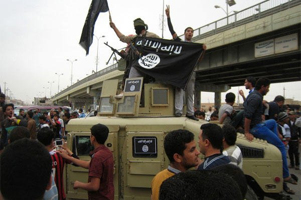 In this March 20, 2014 file photo, Al-Qaida fighters wave al-Qaida flags as they patrol in a commandeered Iraqi military vehicle in Fallujah, Iraq. (AP Photo, File)