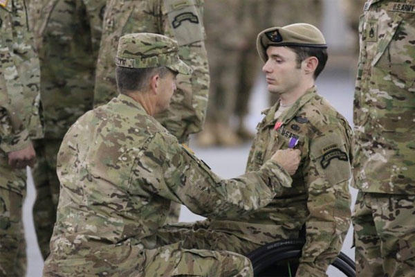 Gen. Daniel B. Allyn, Army vice chief of staff, presents Staff Sgt. Travis D. Dunn, Bravo Company, 1st Battalion, 75th Ranger Regiment, with the Bronze Star with Valor and a Purple Heart, April 29, 2015.(U.S. Army photo/ Pfc. Eric Overfelt)