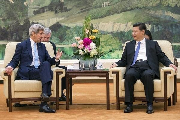 Chinese President Xi Jinping, right, and U.S. Secretary of State John Kerry hold a meeting at the Great Hall of the People on May 17 in Beijing. (AP photo)