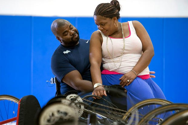 Retired Coast Guard Lt. Sancho Johnson and his wife, Shundra, spend time together during the Navy trials for the Department of Defense Warrior Games in Ventura, Calif., May 29, 2015. DoD photo by EJ Hersom