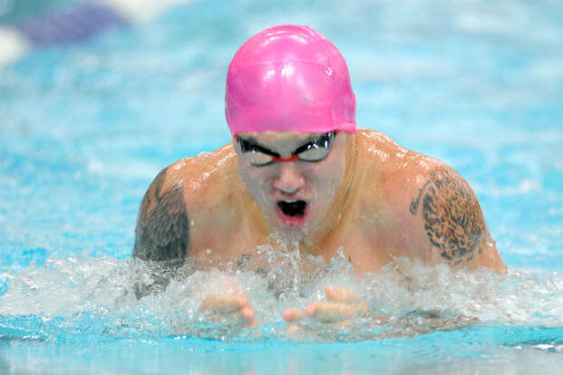 Kyle Reid, then a corporal in the Marine Corps, swims to gold in the 50-meter breaststroke finals during the 2014 Warrior Games in Colorado Springs, Colo., Sept. 30, 2014. (DoD News photo by EJ Hersom)