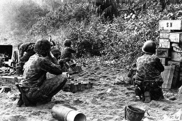 In this Jan. 30, 1944, image provided by the U.S. Marine Corps, U.S. Mariner Raiders capture a Japanese stronghold at Bougainville in the Solomon Islands. (AP Photo/U.S. Marine Corps, File)