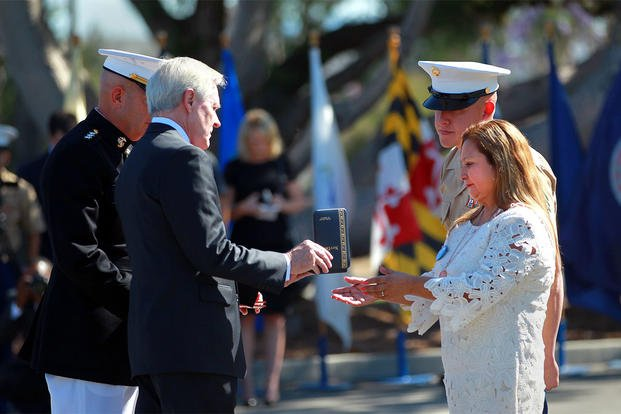 Rosa Peralta, right, mother of Marine Sgt. Rafael Peralta, accepts the Navy Cross presented to her by Navy Secretary Ray Mabus at Camp Pendleton, Calif., Monday, June 8, 2015. (John Gastaldo/San Diego Union-Tribune via AP)