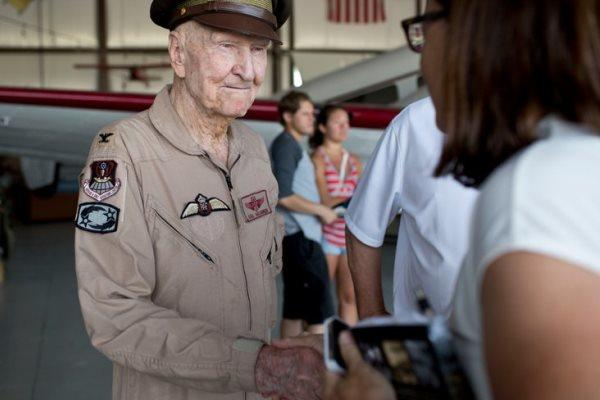 "Gail Halvorsen, known as the ""Candy Bomber,"" signs autographs at Utah's Heber City Airport on July 3. He later helped fly a WWII bomber that dropped 1,000 chocolate bars attached to tiny parachutes at Scera Park. Associated Press"