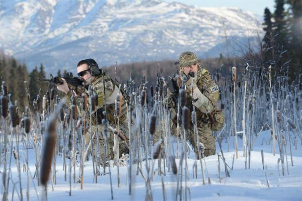 Capt. Jack Fine (left) and Senior Airman Sergio Barcena-Turner, both assigned to the 3rd Air Support Operations Squadron, simulate a patrol March 3, 2014, at Sixmile Lake, Joint Base Elmendorf-Richardson, Alaska. (AF photo)