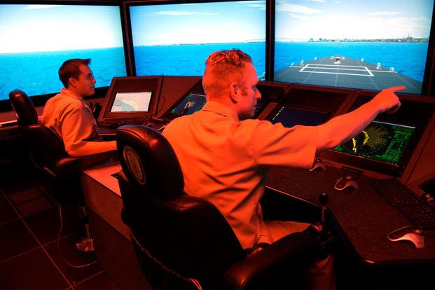 Surface Warfare Officer's School students navigate their virtual vessel through a number of simulated hazards in the school's full-mission bridge, May 16, 2007. (U.S. Navy photo/Mass Communication Specialist 2nd Class Jason McCammack)