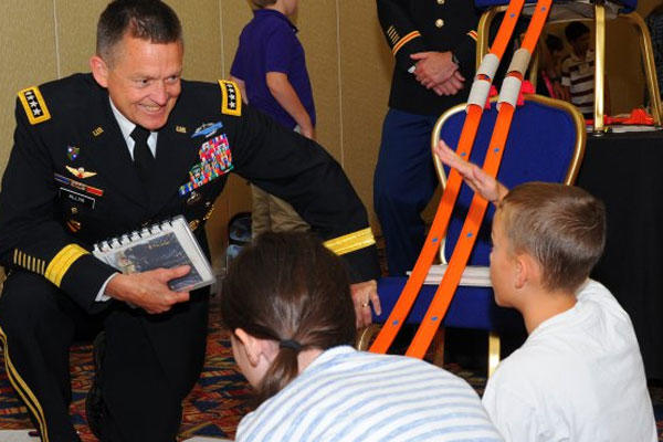 Army Chief of Staff Gen. Daniel Allyn talks with a military child at the 17th Military Child Education Coalition put on by the Military Child Education Coalition and held in Washington, D.C., July 27-28, 2015.(U.S. Army photo/ J.D. Leipold)