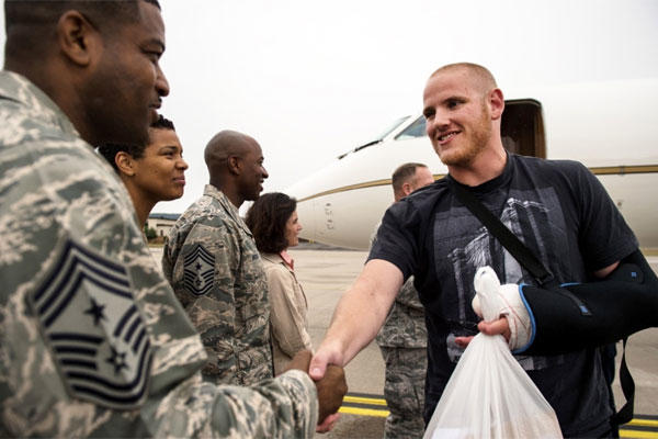 U.S. Air Force Airman 1st Class Spencer Stone meets Chief Master Sgt. Phillip Easton, 86th Airlift Wing command chief, upon his arrival to Ramstein Air Base, Germany, Aug. 24. 2015. (Sara Keller/U.S. Air Force)