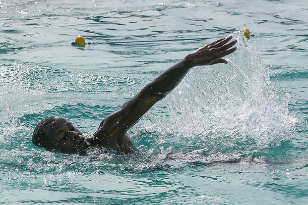 A Compagnie Fusilier de Marin Commando demonstrates his swimming technique during a swim assessment by personnel with Special-Purpose Marine Air-Ground Task Force Crisis Response-Africa, in Dakar, Senegal, Aug. 28, 2015. Photo By: Cpl. Olivia McDonald