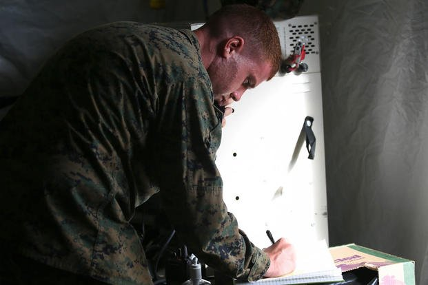 Lance Cpl. Joseph Connelly writes down the locations of each company at the Boondocker Training Area aboard Marine Corps Base Hawaii during training exercise Island Viper, Sept. 22, 2015. Photo By: Lance Cpl. Harley Thomas