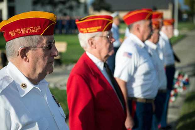 Members of the Marine Corps League Dramis Detachment stand at attention during morning colors on board the Coast Guard Training Center Cape May, Sunday, Sept. 27, 2015. (Photo by Chief Warrant Officer John Edwards)