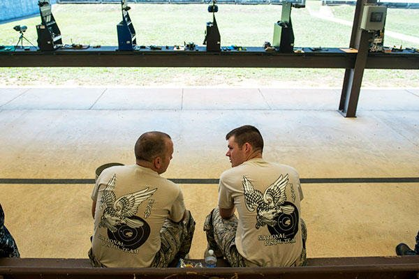 Second Lt. Tucker Sears (right), a 436th Logistics Readiness Squadron material management officer in charge, and his brother, Staff Sgt. Terrence Sears, the Air Force National Pistol Team NCO in charge. (U.S. Air Force/Staff Sgt. Andrew Lee)