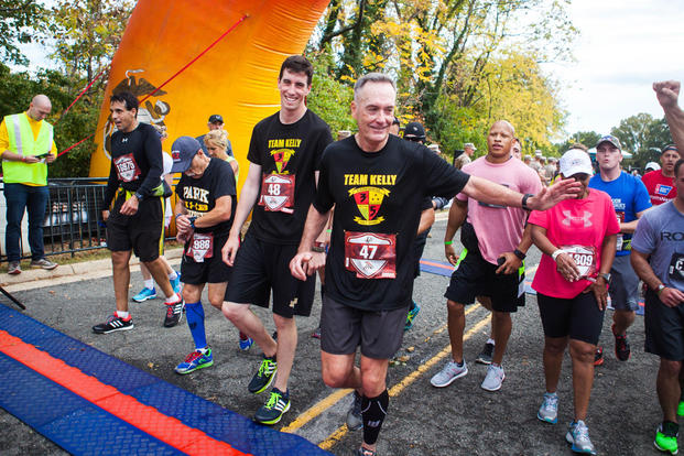 Marine Gen. Joseph Dunford, the chairman of the Joint Chiefs of Staff, completes the 40th Marine Corps Marathon at Arlington, Virginia, Oct. 25. (Photo By: Sgt. Justin M. Boling)