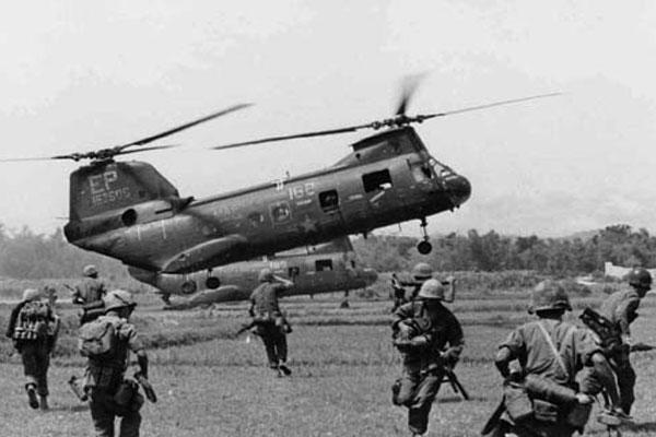 Two CH-46Es from Medium Marine Helicopter Squadron 265, assigned to Marine Aircraft Group 16, 1st Marine Air Wing, unload Marines of the 4th Marine Regiment, 3rd Marine Division into combat north of Phu Bai, South Vietnam, 1966. (U.S. Marine Corps photo)