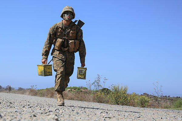 Marine Corps Pfc. Mason A. Davis sprints approximately 100 yards with two ammunition cans during the 12 Stalls event at Edson Range, Marine Corps Base Camp Pendleton, Sept. 23, 2015. (U.S. Marine Corps/Cpl. Jericho Crutcher)