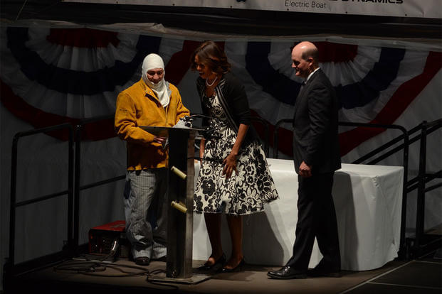 First Lady Michelle Obama authenticates her initials that were welded onto the keel of Pre-Commissioning Unit Illinois (SSN 786), Jun. 2, 2014. (U.S. Navy photo)