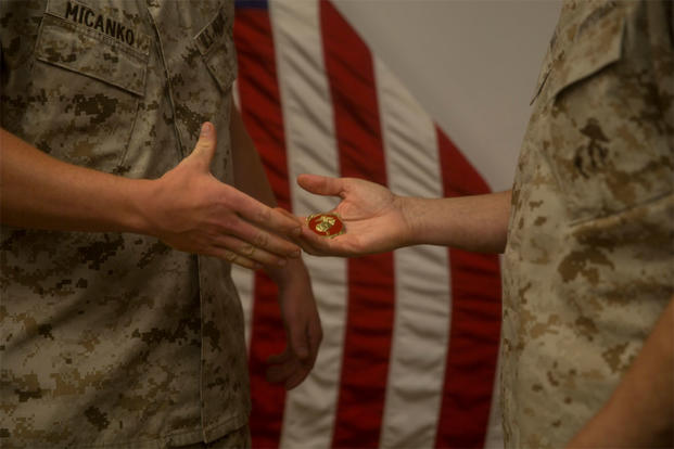 Corporal Steven R. Micanko is presented the Gold Disk Award by Brig. Gen. Robert F. Castellvi, on behalf of the chief of naval operations, aboard Camp Lejeune, N.C., July 7, 2015. (U.S. Marine Corps photo by Lance Cpl. Fatmeh Saad)