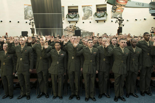 Candidates of Class OCC-220 in Officer Candidate School take their oaths of enlistment during their graduation ceremony at Marine Corps Base Quantico, Virginia. Nov. 24, 2015. (Photo: Lance Cpl. Erasmo Cortez III )