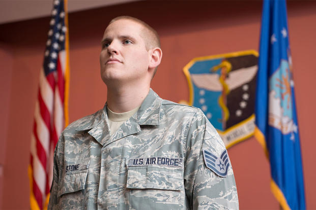 Staff Sgt. Spencer Stone, listens as the responsibilities of noncommissioned offers are read during a promotion ceremony at Travis Air Force Base, Calif., Oct. 30, 2015. (U.S. Air Force photo/Ken Wright)
