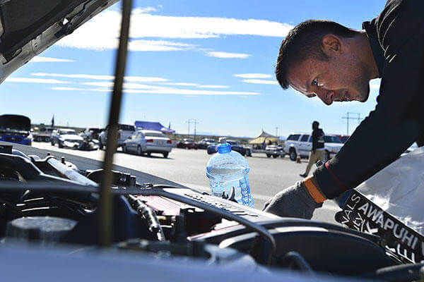 Tech. Sgt. Gabriel, a 432nd Wing/432nd Air Expeditionary Wing MQ-9 Reaper sensor operator, inspects his Mitsubishi Lancer Evolution at the Spring Mountain Raceway Nov. 1, 2015, in Pahrump, Nevada.  (U.S. Air Force/A1C Christian Clausen)
