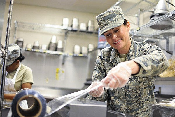 Illinois Air National Guard Airman 1st Class Tanya L. Brown, a services journeyman with the 182nd Force Support Squadron, wraps food after lunch in Peoria, Ill., May 2, 2015. (Illinois Air National Guard/Staff Sgt. Lealan Buehrer)
