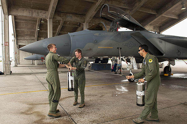 U.S. Air Force Lt. Col. Alexander Haddad, 44th Fighter Squadron pilot, gets sprayed with water by 1st Lts. Maxwell Anthony (left) and Michael Tope, 44th FS pilots, after Haddad reached 2,000 F-15 flying hours. (U.S. Air Force/A1C Corey M. Pettis)