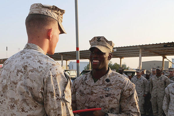 U.S. Navy Petty Officer 2nd Class Ambrose McGill, a hospital corpsman with Special Purpose Marine Air Ground Task Force—Crisis Response—Central Command, is presented his Fleet Marine Force pin. (U.S. Marine Corps/Sgt. Owen Kimbrel)