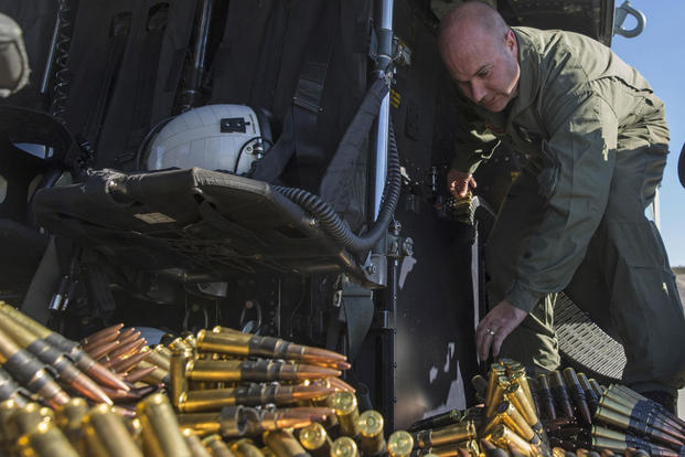 Staff Sgt. Gregory Westhoff prepares the .50 caliber machine gun ammunition for an aerial gunnery shoot at Marine Corps Air Station Camp Pendleton, California, Dec. 17. (Photo: Sgt. Lillian Stephens)