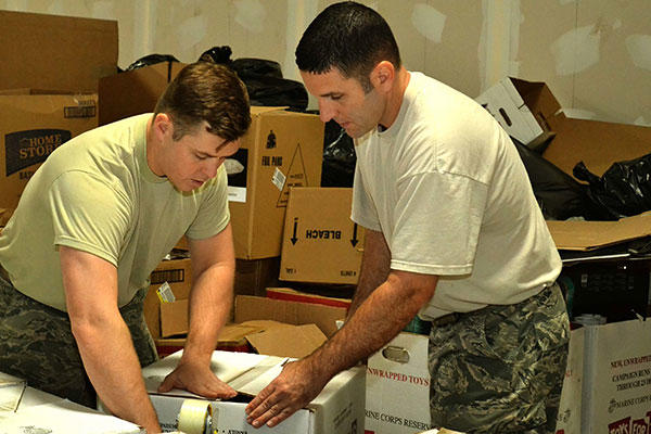 Pennsylvania Air National Guardsmen Airman 1st Class Igor Karlov, left, and Master Sgt. Joe Sommers  at a Toys for Tots warehouse. (Pennsylvania Air National Guard/Tech. Sgt. Andria Allmond)