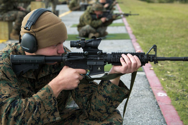 Cpl. James R. Beck, a Fixed-Wing Aircraft Power Plants Mechanic from Marine Corps Air Station Iwakuni, fires on his target during the Far East Division Marksmanship Match Dec. 17 aboard Camp Hansen, Okinawa, Japan. (Photo: Lance Cpl. Doug Simons)