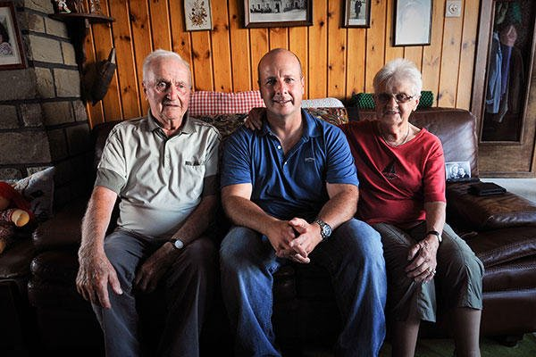 From left, Gaston Mean, an Awyaille, Belgium, resident for more than 70 years, sits with U.S. Air Force Chief Master Sgt. James McCloskey, and Mean's wife, in the living room of the Mean family. (U.S. Air National Guard Senior Airman Shane Karp)
