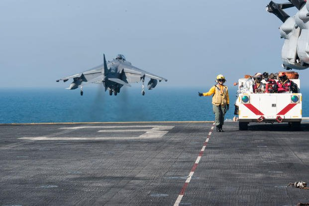 Aviation Boatswain's Mate (Handling) 3rd Class Sarahkate Barambangan, from Los Angeles, directs an AV-8B Harrier to take off from the flight deck of the amphibious assault ship USS Kearsarge. (Photo: Mass Communication Specialist 3rd Class Tyler Preston)