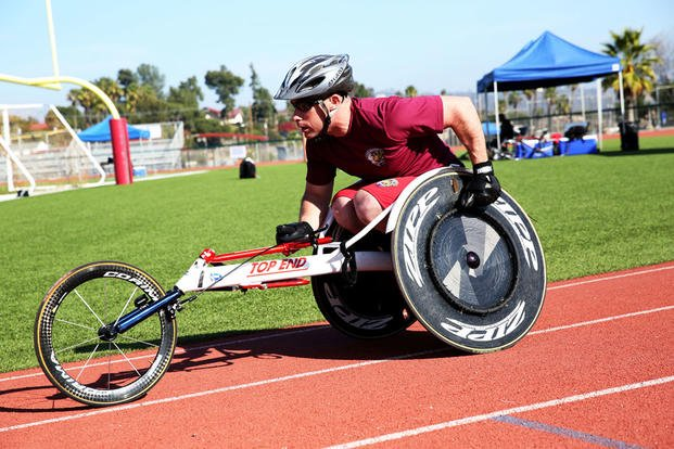 Sgt. David Tupper, 30, from Oldsaybrook, Conn., and member of the Wounded Warrior Battalion East Team, rides around the track during the 2014 Marine Corps Trials March 5, 2014. (Photo: Sgt Anna Albrecht)