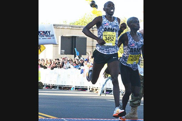 In this file photo, Spc. Paul Chelimo, left, wins the Army Ten-Miler, Oct. 11, 2015, with a time of 48:19, less than a step ahead of his teammate Spc. Nicholas Kipruto. (U.S. Army/David Vergun)