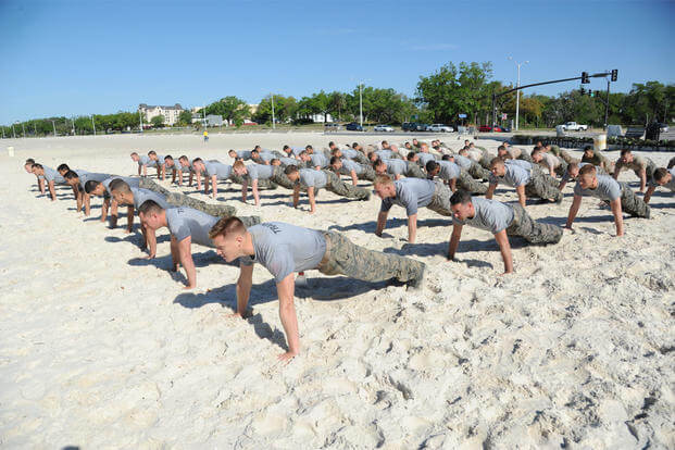 Combat control trainees from the 334th Training Squadron do push-ups during a physical training session April 12, 2013, on Biloxi beach. Combat controllers are ground troops who are embedded with special forces teams. (U.S. Air Force/Kemberly Groue)