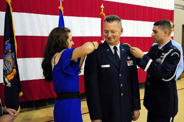 New York Air National Guard Maj. Gen. Anthony German, commander of the New York Air National Guard, receives his two-star rank from his daughter Beckah and son, Air National Guard Capt. Joshua German, on June 22, 2015. (National Guard/SFC Steven Petibone)
