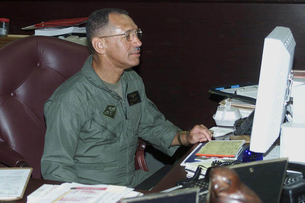 "Charles ""Charlie"" Bolden, the 12th Administrator of NASA works at his desk at an unknown location and date. (Photo: U.S. Marine Corps)"