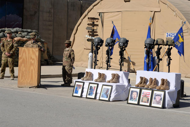 Maj. Met Berisha, 455th Expeditionary Security Forces Squadron commander, shares his condolences for 6 fallen Airmen during a fallen comrade memorial ceremony Oct. 3, 2015, at Bagram Airfield, Afghanistan. (U.S. Air Force/Senior Airman Cierra Presentado)