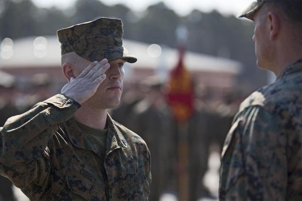 Cpl. Joseph Currey, left, salutes Lt. Col. Jeremy Winters, right, during an award ceremony at Marine Corps Air Station Cherry Point, North Carolina, March 1, 2016. (Photo: Lance Cpl. Austin Lewis)