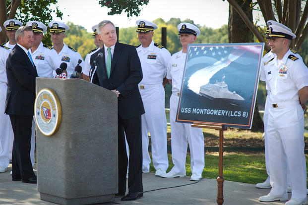 Secretary of the Navy (SECNAV) Ray Mabus and Montgomery Mayor Todd Strange, left, celebrate the naming of the eighth littoral combat ship, USS Montgomery (LCS 8), Oct. 6, 2011. (Photo: Chief Mass Communication Specialist Sam Shavers)
