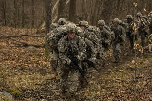A team from the U.S. Military Academy's Corps of Cadets make the 6 mile trek across the Appalachain Mountain range during the 2016 Sandhurst competition held at West Point, N.Y., April 8, 2016. (U.S. Army photo/Sgt. 1st Class Brian Hamilton)