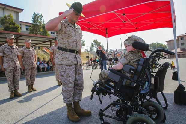 Marine Corps Recruit Depot San Diego presented the title of Honorary Marine to Wyatt Seth Gillette in a ceremony at the School of Infantry-West Parade Deck, Marine Corps Base Camp Pendleton, Calif., July 30, 2016.. (Angelica Annastas/U.S. Marine Corps)
