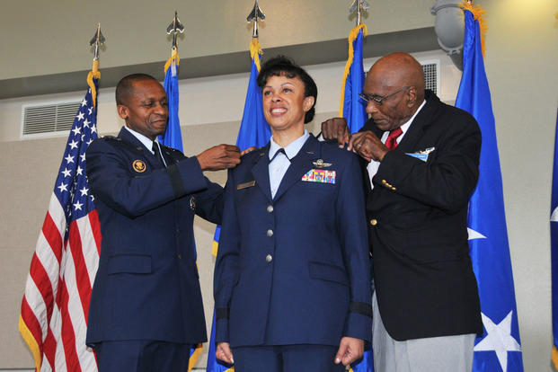 Gen. Darren W. McDew and Hillard W. Pouncy, original Tuskegee Airman, pin stars on then Maj. Gen. Stayce D. Harris, during a promotion ceremony Aug. 9, 2014 at Dobbins Air Reserve Base, Ga. (U.S. Air Force photo/Staff Sgt. Jaclyn McDonald)