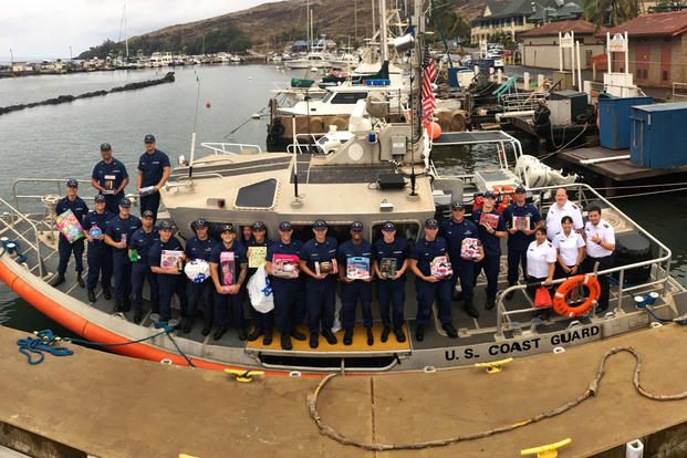 Members of Coast Guard Station Maui team up with the Salvation Army to deliver 800 toys and clothes to the children of Molokai Dec. 9, 2016. (U.S. Coast Guard photo/Petty Officer 2nd Class Rob Lester)