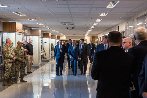 Former Defense Secretary Chuck Hagel, flanked by Defense Secretary Ash Carter and Michael Rhodes, arrive for the opening of a Pentagon exhibit commemorating the 50th anniversary of the Vietnam War, Dec. 20, 2016. (DoD/Air Force Staff Sgt. Jette Carr)