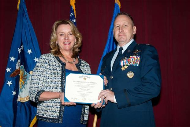 Air Force Secretary Deborah Lee James presents Col. Christopher C. Barnett, an Air War College faculty member, the Silver Star and the Silver Star first oak leaf cluster Jan. 19, 2017. (US Air Force/Melanie Rodgers Cox)