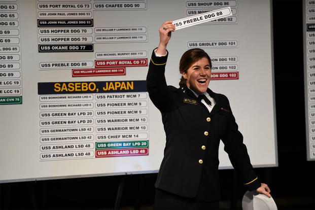 Midshipman First Class Hannah J. Meadows holds a sign for the guided-missile destroyer USS Preble (DDG 88) during Ship Selection Night at the U.S. Naval Academy, Jan. 26, 2017. (U.S. Navy/Mass Communication Specialist 2nd Class Tyler Caswell)