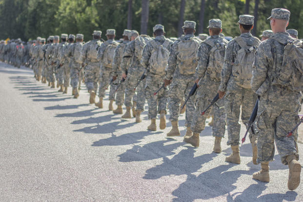 U.S. Army recruits road march single-file across Fort Jackson, S.C., June 13, 2015. (U.S. Army photo by Sgt. Ken Scar)